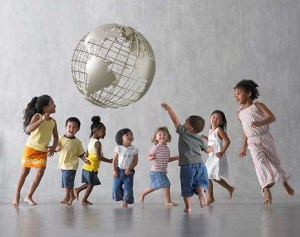 kids with different physical characteristics playing together under a globe