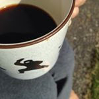 white coffee cup with black ninja silouette